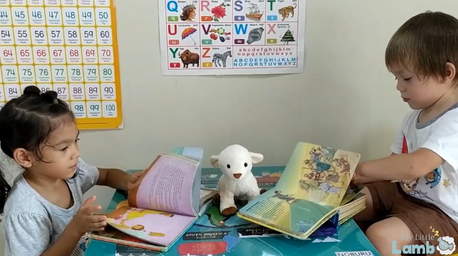 Little Boy and Girl reading Bible stories with My Little Lamb, a soft toy with integrated audio player