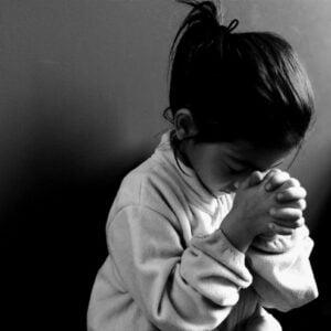 small girl praying